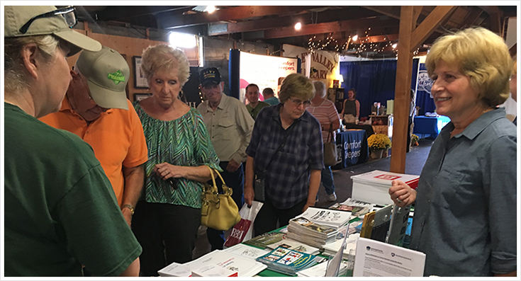 Senator Schwanks speaks with constituents at her booth at the Oley Fair
