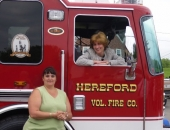 Senator Schwank presents Hereford Volunteer Fire Company with a state flag commemorating the housing.