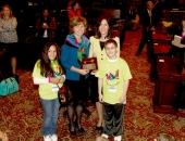 Fifth grader Devynne Valentin, Sen. Judy Schwank, reading specialist Dr. Argyro Elliker and fifth grader Broderic Shipe