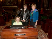 "Third grader and ""Plants\"" poem author Sara Miller, her mother Valerie, and Sen. Judy Schwank"