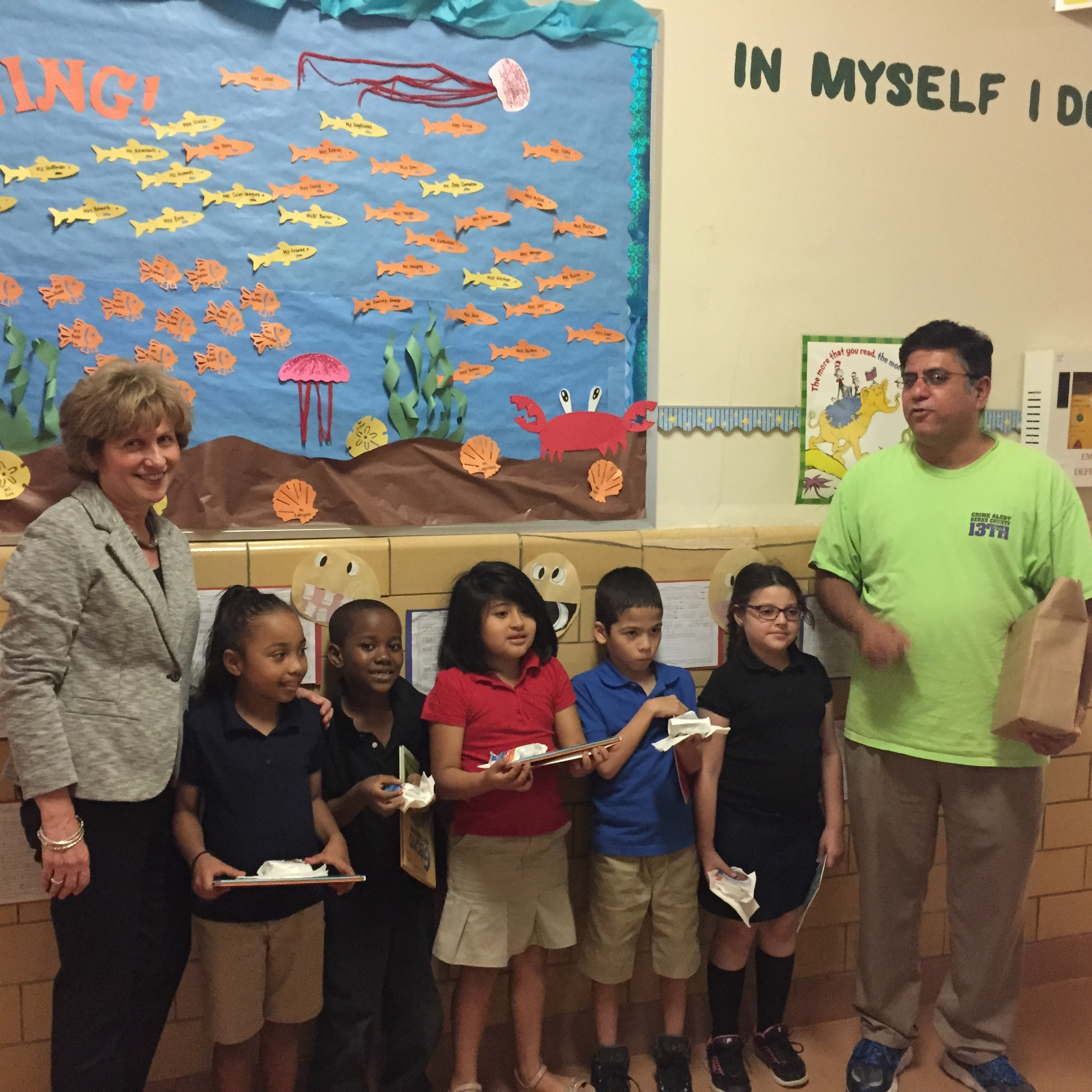 May 29, 2015:Senator Schwank and Dairy Queen Owner Hamid Chaudry distributed free ice cream sandwiches and new books donated by the United Way at one of the Reading elementary schools.