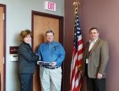 Senator Schwank presents a U.S. flag to Lewis Gable Caernarvon Township Supervisor and Randall Miller Township secretary