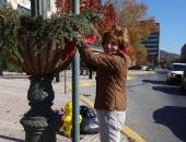 Senator Judy Schwank decorates pole planters on Penn Street, Reading Pa  :: November 12, 2011